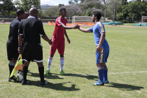 Two captains shake hands before game in Kayamandi