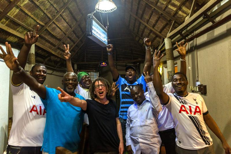 The author at home with Spurs fans in Lagos